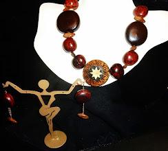Photo: <BEREHYNYA> {Great Goddess Protectress} unique one-of-a-kind statement jewellery by Luba Bilash ART & ADORNMENT  REBIRTH - ВІДРОДЖЕННЯ - straw & wood burned pendant, beach hearts & bibako seeds, wood, rose gold vermеil hook clasp/chains/French wires SOLD