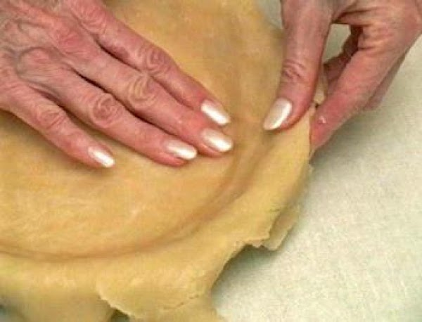 Step 5 - Gently ease the pie dough into the shape of the pan....
