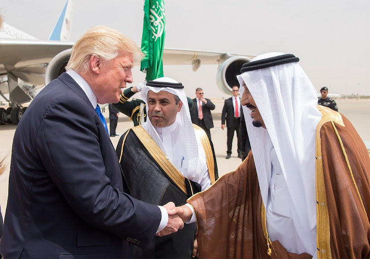Saudi Arabia's King Salman bin Abdulaziz Al Saud, right, shakes hands with US President Donald Trump during a reception ceremony in Riyadh, Saudi Arabia on Saturday.   Picture: REUTERS