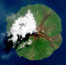 Photo: NASA image acquired June 16, 2010.Papua New Guinea's Manam Volcano released a thin, faint plume on June 16, 2010, as clouds clustered at the volcano's summit. The Advanced Land Imager (ALI) on NASA's Earth Observing-1 (EO-1) satellite took this picture the same day. Rivulets of brown rock interrupt the carpet of green vegetation on the volcano's slopes. Opaque white clouds partially obscure the satellite's view of Manam. The clouds may result from water vapor from the volcano, but may also have formed independent of volcanic activity. The volcanic plume appears as a thin, blue-gray veil extending toward the northwest over the Bismarck Sea.Located 13 kilometers (8 miles) off the coast of mainland Papua New Guinea, Manam forms an island 10 kilometers (6 miles) wide. It is a stratovolcano. The volcano has two summit craters, and although both are active, most historical eruptions have arisen from the southern crater.NASA Earth Observatory image created by Jesse Allen, using EO-1