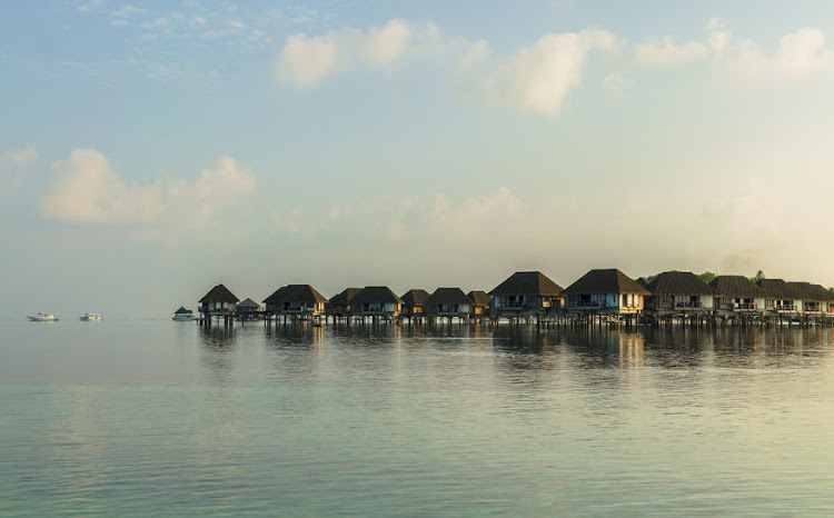 Many of the resorts in the Maldives have villas built on stilts over a turquoise sea.