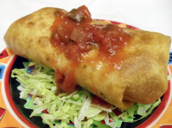 Prepare a bed of shredded lettuce on serving plate. Place 2 chimichangas in lettuce....