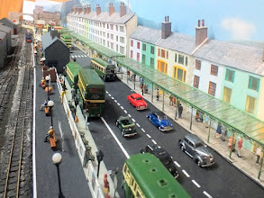 Photo: 016 Porth-y-Castell station is situated in the main shopping street which features an overall pavement awning running the whole length of the shop fronts. Note the number of buses and coaches – Martyn Davies is a bus and particularly Crosville enthusiast !