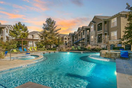 Dry Creek Ranch Apartments sparkling pool at dusk