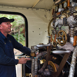 Operating A Steam Locomotive by Garry Dosa - People Professional People ( wheels, outdoors, objects, levers, working, man, panel, operator, train,  )