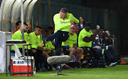 A frustrated Bidvest Wits coach Gavin Hunt kicks in the air during the Absa Premiership match against Cape Town City FC at Bidvest Stadium in Johannesburg on March 02, 2019.