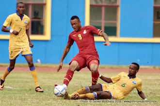 Photo: Yannick MUKUNZI (6) makes a sliding tackle on Jordan Ayew (9) [Rwanda Vs Ghana AFCON2017 Qualifier, 5 Sep 2015 in Kigali, Rwanda.  Photo © Darren McKinstry 2015
