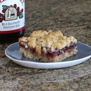 Raspberry Bars With Coconut and Crumb Topping.