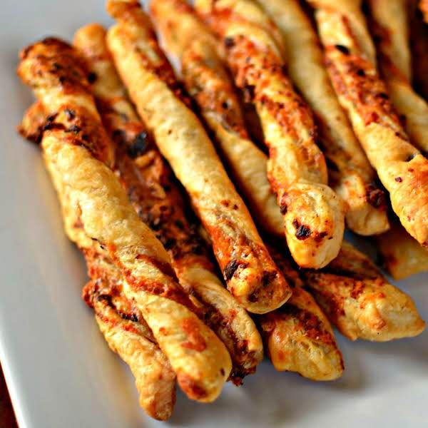 Delectable Party Perfect Cheese And Bacon Straws Made Easy With Frozen Puff Pastry Available In The Freezer Section Of Most Grocery Stores.  These Perfectly Seasoned Crisp Pastry Appetizers Are Perfect For Your Next Party Or Shindig.