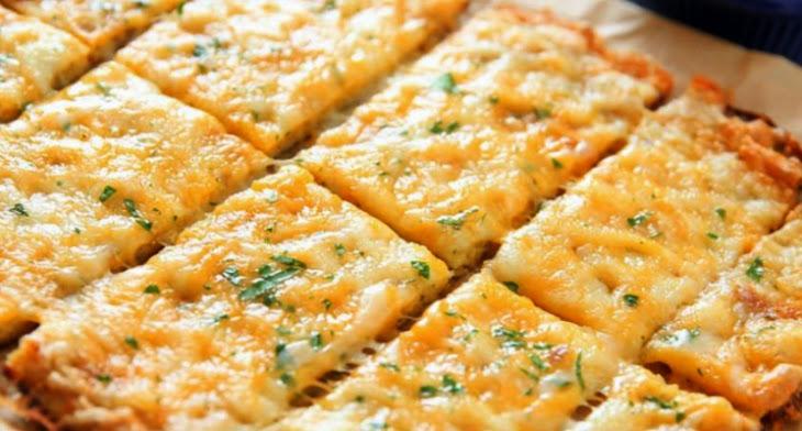 Cheesy Garlic Cauliflower Bread Sticks Recipe | Yummly