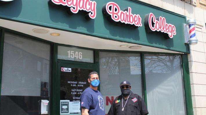A person wearing a mask and standing in front of a store  Description automatically generated with low confidence