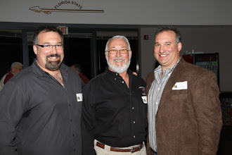 Photo: 1990 - 1992 Teams Reunion in the Varsity Club the night before the NC State game.
