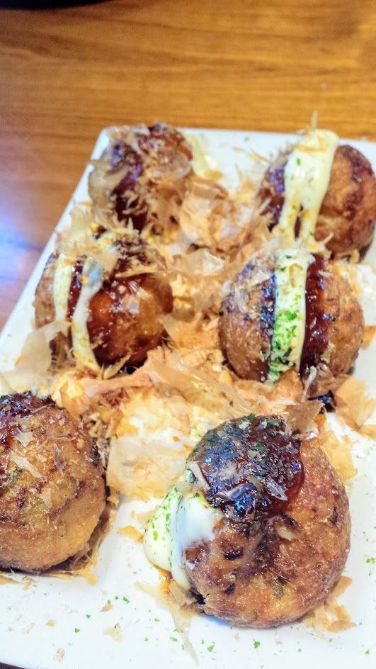 Kizuki Ramen & Izakaya in Beaverton, Takoyaki Octopus Dumplings with aonori, okonomi sauce, mayo and bonito flakes