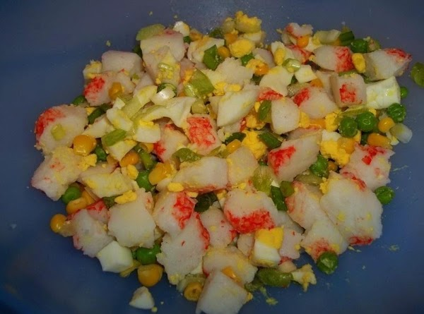 Toss all salad ingredients in a medium sized bowl; spoon on dressing and toss...
