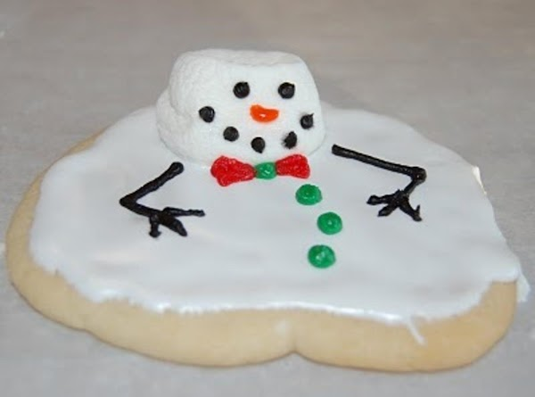 Roll out sugar cookies onto a lightly floured surface until 1/3-1/2 inch thick. Cut...