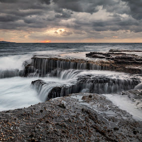 Cascades In The Ocean by Geoffrey Wols - Landscapes Waterscapes ( clouds, water, waterfalls, sunrise, rocks, gushing, sussex inlet,  )