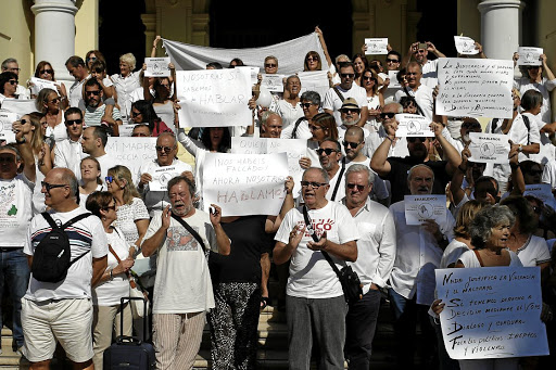 People take part in a gathering in favour of a dialogue to resolve Catalonia's bid for independence, in Malaga, Spain, on October 7 2017. Picture: REUTERS