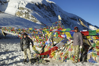 Photo: Hanging prayer flags on the top of Thorong La