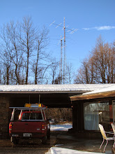 Photo: 120' 10m self supporting tower (foreground) and 180' guyed 40m tower (background)