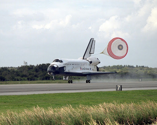 Orbiter Endeavour slows for a full touchdown on Runway 15 at the KSC Shuttle Landing Facility.