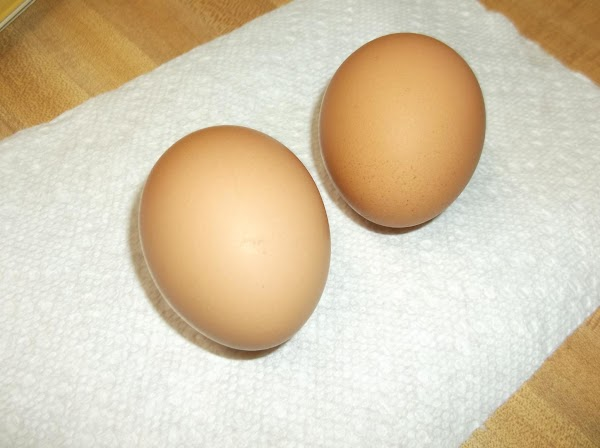 In a small bowl or cup, beat eggs and the 1/3 cup water with...