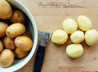 First, select potatoes that are relatively the same size so they cook at the...