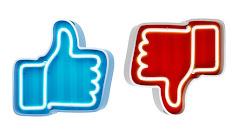 Los símbolos de like y dislike simbolizan las interacciones de las redes sociales