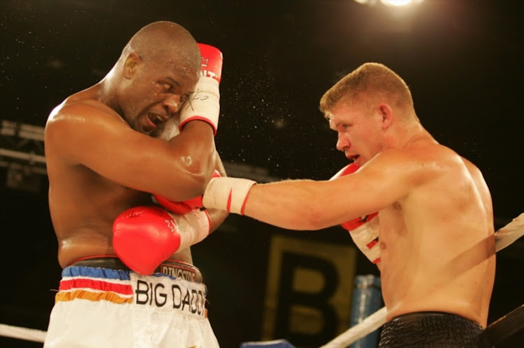 Osborne Machimana(white/gold/red/black trunks) and Pieter Cronje(white/navy/blue) during the South African Light Heavyweight Title match held at Emperors Palace Casino in Kempton Park, Gauteng.