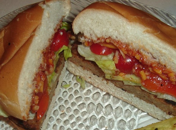 To assemble place the ketchup mixture on the top bun and place the shredded...