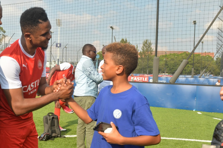 Cameroon and Barcelona legend Samuel Eto'o shares a light moment with the son of South Africa football legend Mark Haskins, Mikael Haskins, during the Castle Africa 5's Media Launch at Discovery Soccer Park on January 11, 2018 in Johannesburg, South Africa.