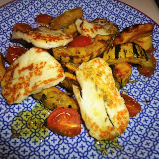 Rosemary and Maple Baked Delicata Squash with Halloumi and Tomatoes.