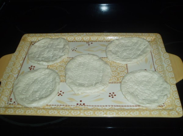 Flatten out your biscuits into pizza rounds. You can choose your size. Since I...
