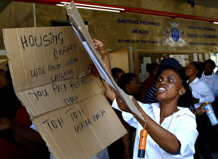 VPS staff protest at the Gauteng Department of Human Settlements offices. Picture: Simphiwe Nkwali