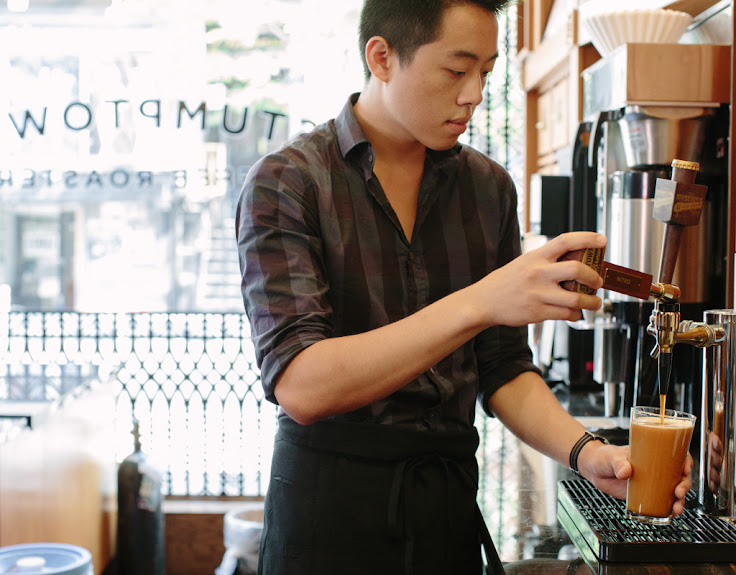 The barista pours a cold brew coffee from the draft. Photo: Stumptown.