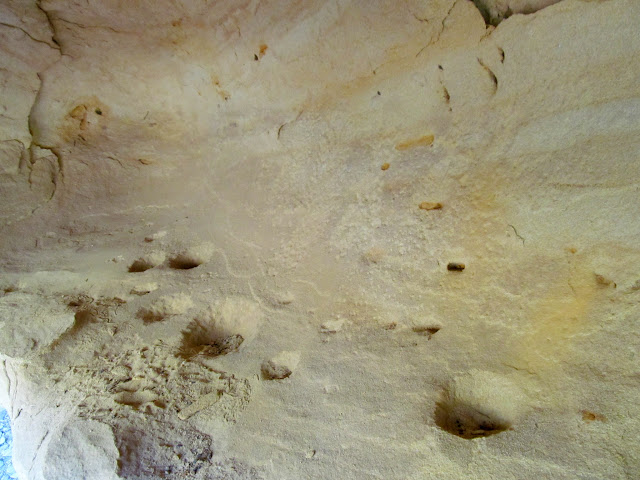 Petroglyphs and deeply-pecked holes