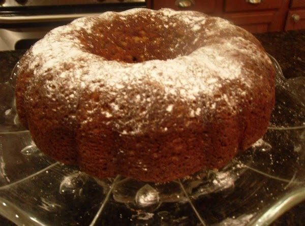 When cake has cooled, turn onto a plate and dust with powdered sugar or...