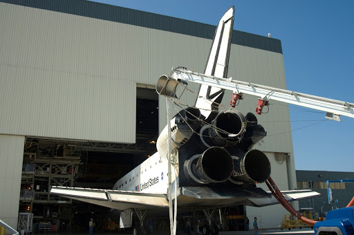 Space shuttle Discovery is towed into bay No. 3 at the Orbiter Processing Facility at NASA's Kennedy Space Center.