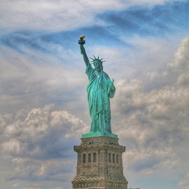 Statue of liberty by Dhritika Saikia - Buildings & Architecture Statues & Monuments ( statue, statue of liberty, sky, vacation, america, blue, cloudy, new york )