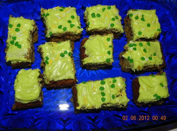 Add food coloring to frosting; spread over the bars. Cut into squares. Enjoy!All dressed...