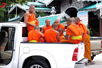 Photo: young novice monks in a pickup truck outside Wat Jong Kham