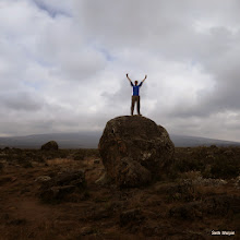 Photo: Liam reaching for the sky, Kili is lost in the clouds behind him. Soon to come.