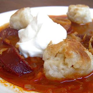 Sausage and Sauerkraut Stew with Duck Fat Dumplings.