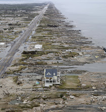 Photo: GILCHRIST, TX - SEPTEMBER 14:  A home is left standing among debris from Hurricane Ike September 14, 2008 in Gilchrist, Texas. Floodwaters from Hurricane Ike are reportedly as high as eight feet in some areas causing widespread damage across the coast of Texas.  (Photo by David J. Phillip-Pool/Getty Images)