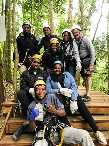 The writer, back right, and friends with Tsitsikamma Canopy Tour guide Heiney Jacobs, front.