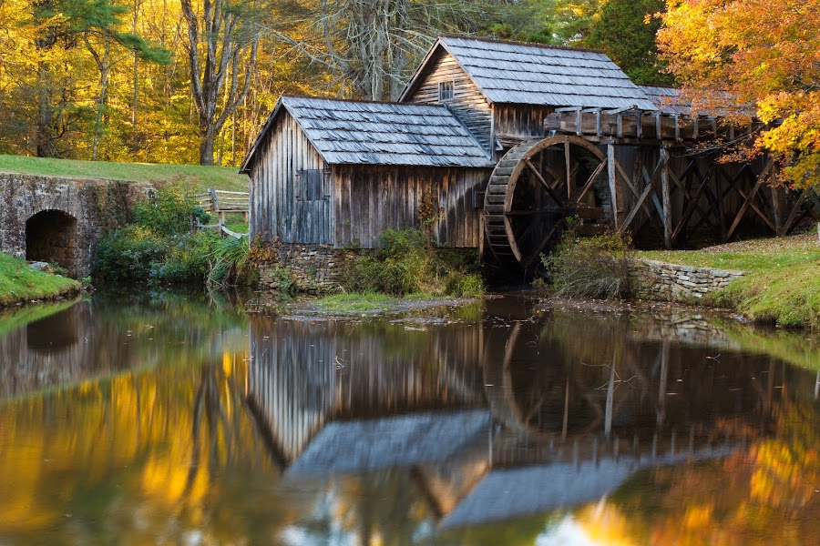 by Paul Krugman - Buildings & Architecture Public & Historical ( shop, reflection, old, parkway, wood, wheel, appalachia, yellow, road, sawmill, leaves, landscape, rustic, weathered, ridge, mill, tree, nature, autumn, virginia, va, pond, evening, water, orange, structure, building, park, vintage, texture, national, woodworking, green, tourism, forest, scenic, watermill, rural, gristmill, blacksmith, landmark, grist, mabry, season, blue, outdoors, fall, scenery )