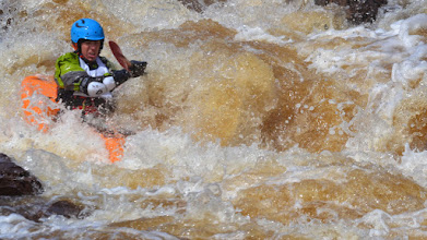 Photo: An unidentified kayaker makes his way down the rapid called Naked Man in the first heat of the Lester River Race.