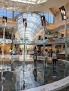 Získat navigační instrukce do The Mall at Millenia Orlando