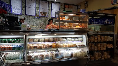 Aladdin Sweets & Restaurant Parking - Find Cheap Street Parking or Parking Garage near Aladdin Sweets & Restaurant | SpotAngels