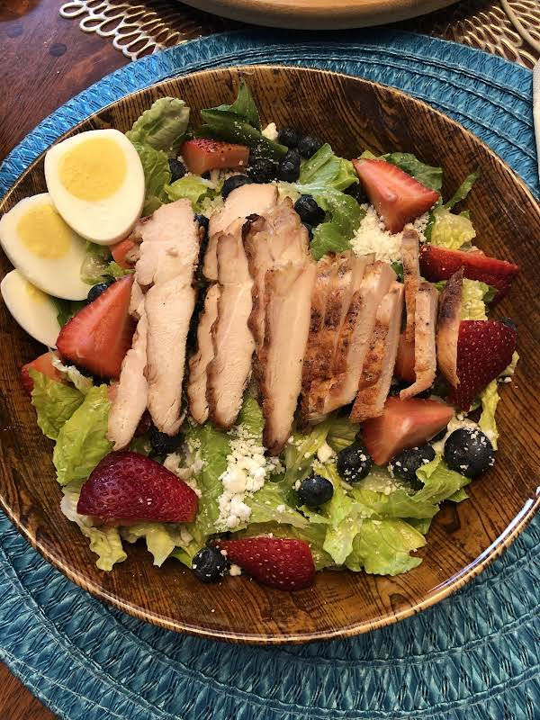Grilled Chicken On A Bed Of Crispy Romaine With Fresh Strawberries, Blueberries & Feta Cheese.