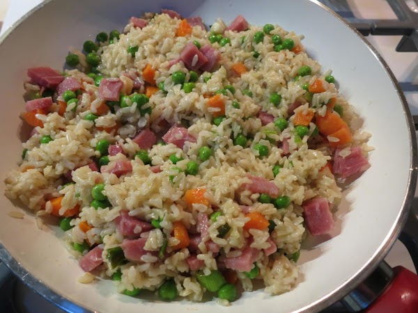 Add peas, carrots and ham.  Saute for 2 - 4 minutes more.Meanwhile stir...